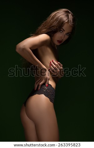 woman in black panties cover her breast - stock photo