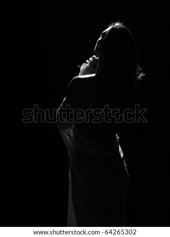 Woman in body style studio shot looking towards the light - stock photo