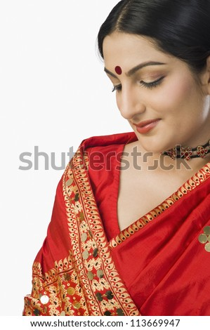 Woman in bright red mekhla - stock photo