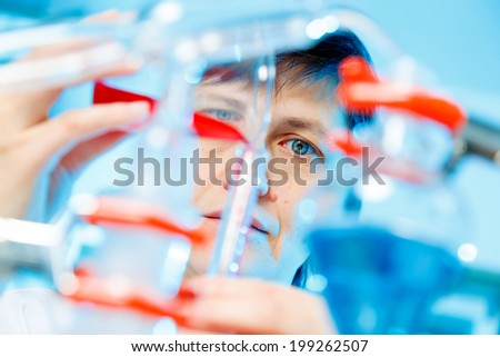 Woman in chemistry lab - stock photo
