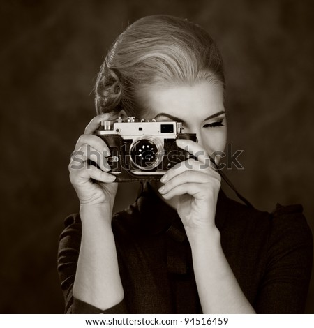 Woman in classic dress with retro camera. - stock photo