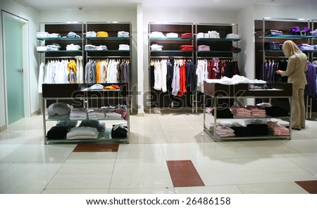 Woman in clothing department - stock photo