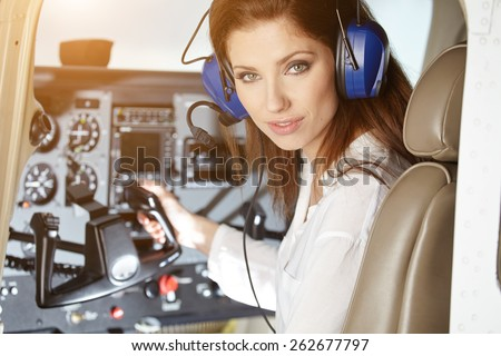 woman in cockpit - stock photo