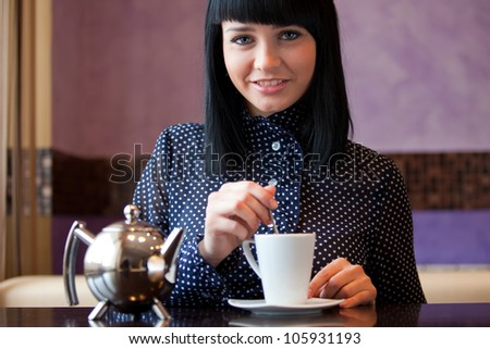 woman in coffee with cup and teapot - stock photo