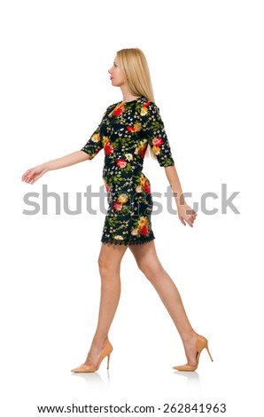 Woman in dark green floral dress isolated on white - stock photo