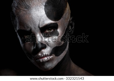 Woman in day of the dead mask skull face art. Halloween face art on black background - stock photo