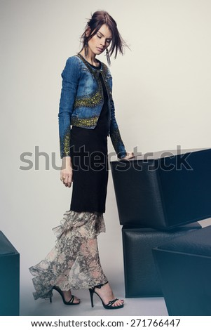 Woman in denim jacket and long dress - stock photo