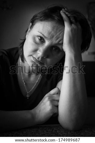 Woman in depression. Black and white portrait - stock photo