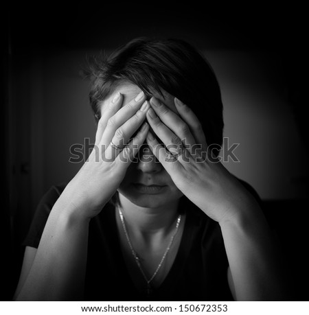 Woman in depression. Black and white portrait series - stock photo