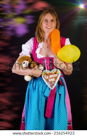 Woman in dirndl won some prizes at Oktoberfest - stock photo