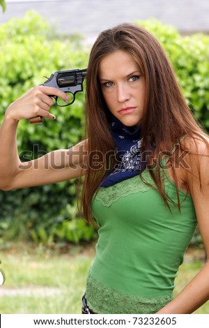 Woman in Distress Appears to be Ready to Commit Suicide Holding Handgun to Her Temple - stock photo