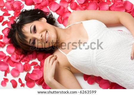Woman in Flower Petals - stock photo