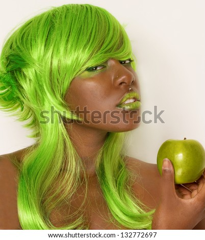 Woman in Green Wig With Green Apple - stock photo