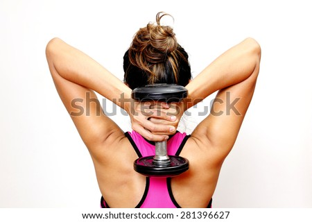 woman in gym exercises weight lifting - stock photo