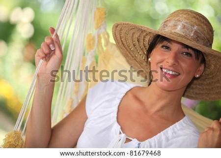 Woman in hammock - stock photo