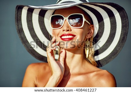 Woman in hat and sunglasses - stock photo