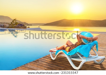 Woman in hat enjoying sun holidays in Greece - stock photo