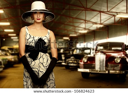 Woman in hat in retro garage - stock photo
