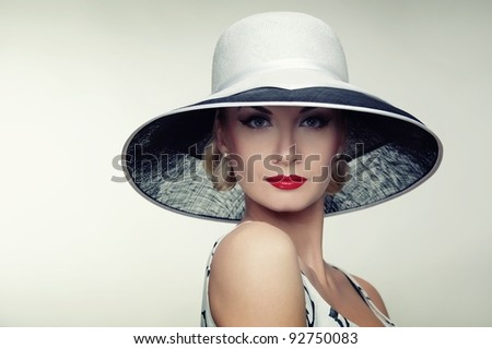 Woman in hat retro portrait. - stock photo
