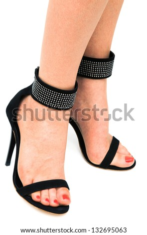 woman in high heels on a white background - stock photo
