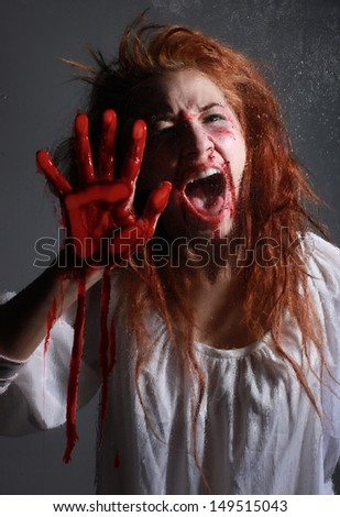 Woman in Horror Situation With Bloody Face - stock photo