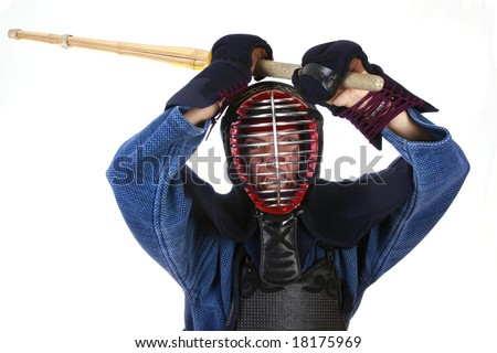 Woman in kendo (japanese fencing) helmet prepared to attack. - stock photo