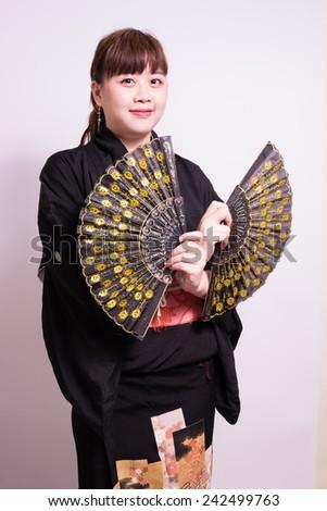 Woman in kimono with blow. - stock photo