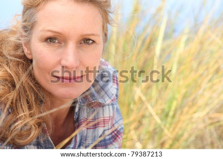 Woman in long grass - stock photo