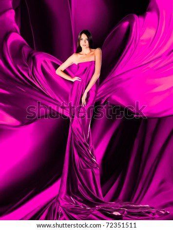 woman in long red dress on red fabric - stock photo