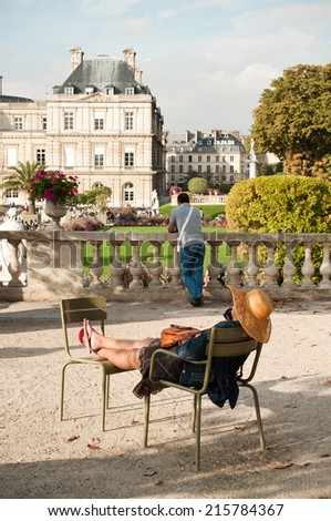 woman in Luxembourg Gardens in Paris, France - stock photo