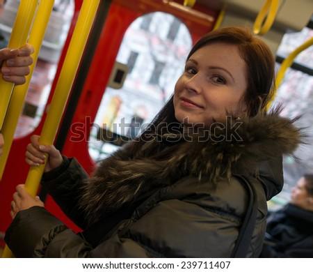 woman in metro   - stock photo