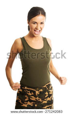 Woman in military clothes showing her agressivity by screaming and making fists. - stock photo