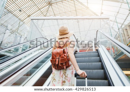 woman in modern airport, people traveling with luggage - stock photo