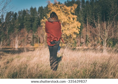 Woman in nature enjoys the view  - stock photo