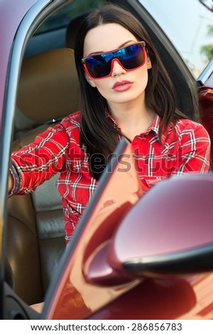 Woman in new car. - stock photo
