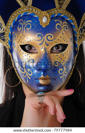 Woman in Ornate Venetian Mask - stock photo