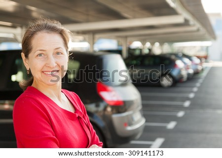 woman in  parking lot  at sunny day.  - stock photo
