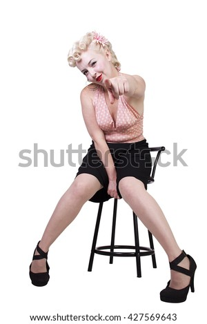 Woman in pin-up dress pointing finger at the camera - Isolated White Background - stock photo