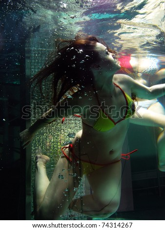 Woman in pool - stock photo