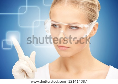 woman in protective glasses and gloves working with virtual screen - stock photo