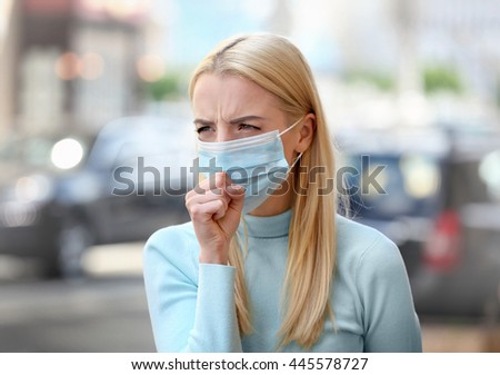 Woman in protective mask outdoors - stock photo
