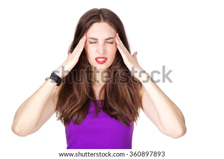 Woman in purple tank top having strong headache and holding her head with hands. Fit and athletic Caucasian brunette girl posing on white background. - stock photo