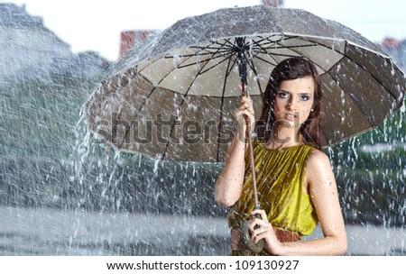 woman in rain on street - stock photo