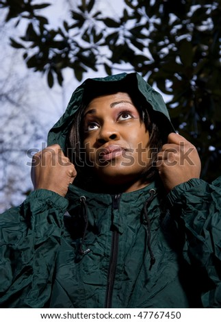 Woman in Raincoat - stock photo