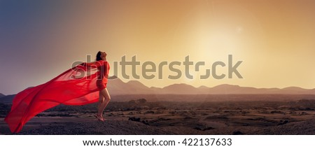 woman in red basking in the morning sun - stock photo