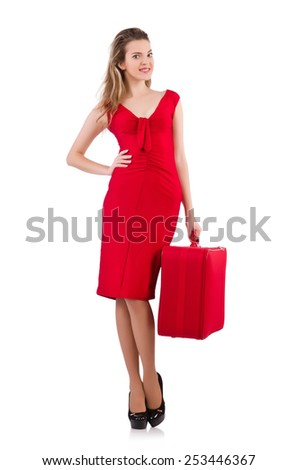 Woman in red dress and travel case isolated on white - stock photo