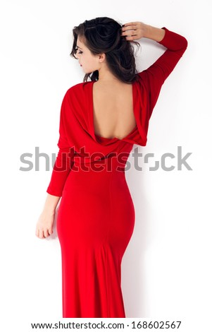 woman in red dress shot from the back - stock photo
