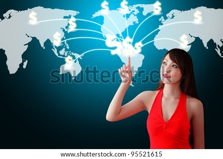 Woman in red dress touch the Money icon on the World map - stock photo