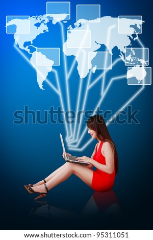 Woman in red dress using notebook computer and connect to world map - stock photo