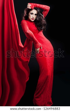 Woman in red dress with curly and  bright make up. Valentines day, - stock photo
